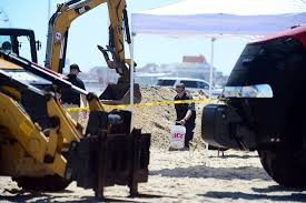 vacationer found buried on maryland beach what to know