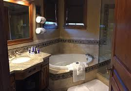 Spa Type Bathrooms - suite 473 bathroom with large shower and spa type tub picture of