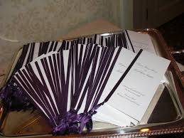 Wedding Programs With Ribbon On A Tray Jpg