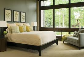 charming lime green upholstered queen bed with cube wall mirror