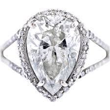 Pear Shaped Wedding Ring by White Gold Pear Shaped Diamond Halo Style Pave Engagement Ring