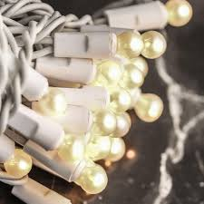 pearl white globe bulb and white cord string lights lighting