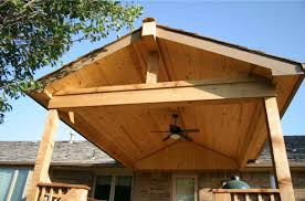 Covered Patio Designs Pictures by Covered Porch Handsome Hand Carved Arches Grace The Exterior