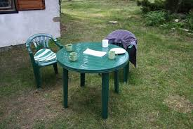 resin patio table with umbrella hole home depot patio chairs wicker rocking chair lowes resin patio table