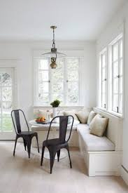 lovely eat in kitchen is filled with a built in dining bench and