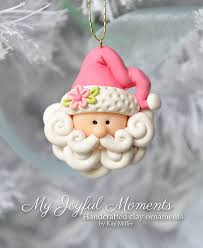 this is s one of a handcrafted santa ornament made of