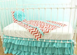 Coral Bedrooms Bedroom White Crib With Coral And Turquoise Bedding Plus Wooden