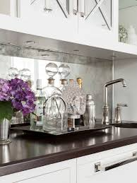 mirrored backsplash in kitchen antiqued mirrored backsplash transitional kitchen susan