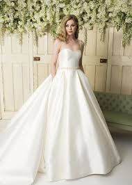 a mikado satin ball gown with a pleated skirt and beaded straps