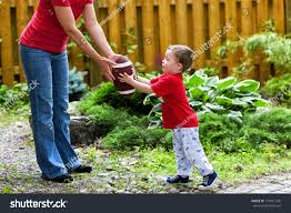 small boy receives hand off his stock photo 174417305 shutterstock