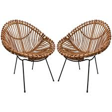 pair of bamboo chairs in the style of franco albini modern