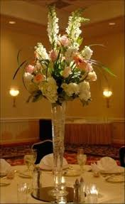 tall wedding centerpieces tall pedestal vase with white flowers