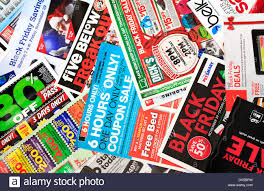 sale papers advertising deals on black friday day after stock