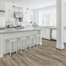 white kitchen cabinets with vinyl plank flooring mohawk home cascade oak waterproof rigid 5mm thick luxury vinyl plank flooring 1mm attached pad included