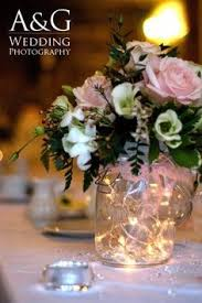 flower centerpieces for wedding with tiny lights http www