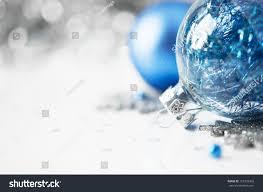 blue silver xmas ornaments on bright stock photo 157328363
