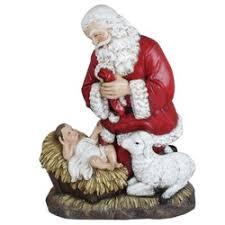 santa kneeling at the manger kneeling santa christmas gifts the catholic company