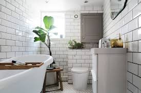 all tile bathroom before after an all beige bathroom becomes a scandinavian