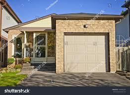 small bungalow suburban small bungalow house single garage stock photo 110409254