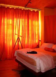 Burnt Orange Curtains Bedroom Design Excellent Sliding Orange Curtains With White Bed