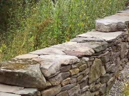 dry stack rock wall for the front circle garden garden ideas
