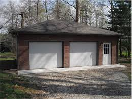 just garages brick on the front of this two car garage adds extra appeal two
