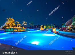 swimming pool luxury caribbean resort night stock photo 122786008