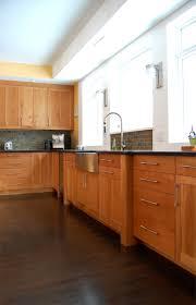 kashmir cream granite with natural cherry kitchen cabinets cherry cabinets black countertops stone backsplash sleek hardware