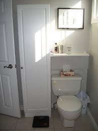 wall lighting idea above black diy bathroom cabinet ideas over