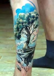 tree on calf tattoo idea
