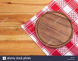 Wooden Table Top View Pizza Board With Napkin On Wooden Table Top View Mockup Stock
