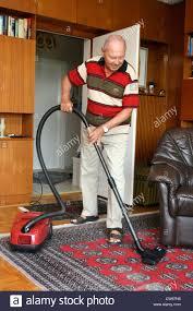 senior when vacuuming stock photo royalty free image 49924932