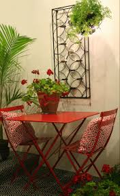 Small Balcony Furniture by Geraniums Fairy Lights Around A Hanging Basket And A Red Fermob