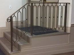 white wood staircase handrail and white wrought iron staircase