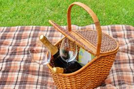 wine picnic baskets picnic basket with plates food wine bottles and two wineglasses