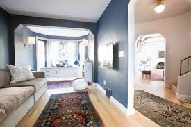 living room glossy hardwood flooring floating mdf shelves blue