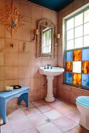 20 interiors that embrace the warm rustic beauty of terracotta tiles gorgeous rustic bathroom with terracotta tiles for the wall and flooring from anna addison
