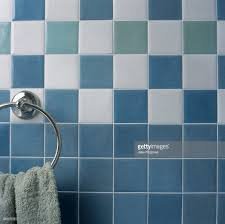 towel holder fitted into bathroom wall covered in ceramic tiles