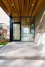 modern glass house glass front door riverside home in ottawa canada