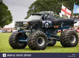 monster trucks monster truck crushing cars stock photos u0026 monster truck crushing
