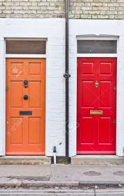 Front Door Red by Red And Orange Front Doors On Adjoining Terraced Homes In The