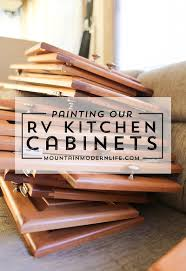 painted kitchen cabinets mountainmodernlife planning paint your tiny kitchen and considering using black check out these two