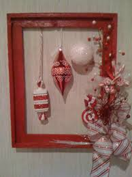 alternative christmas wreath made from a repurposed picture frame