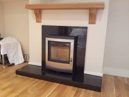 esse inset wood burning stove with granite fireplace u0026 oak