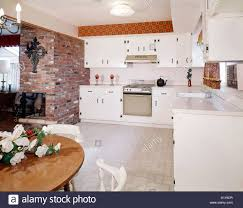 Country Cabinets For Kitchen 1960s Kitchen Interior With Brick Wall And White Country Cabinets