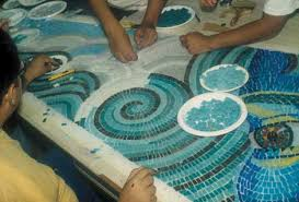 how to make a mosaic table top art projects for beginners tiles are nipped and then laid out on a