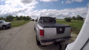 nissan titan long travel nissan titan vs low water crossing pulling a 31 foot camper youtube