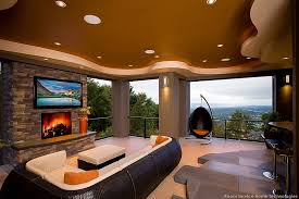 TV Above Fireplace Design Ideas - Outdoor family rooms