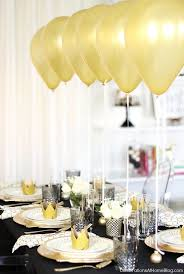 holiday table setting with balloons centerpiece celebrations at home