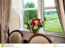 window with curtains and flowers stock photo image 57606988